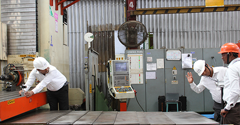 Godrej personnel calibrating a CNC machine with an XL-80 laser