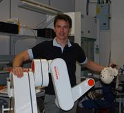 John Barrowman with a Renishaw neuromate surgical robot
