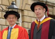 Sir David McMurtry (l) receives Honorary Doctor of Engineering Degree from the University of Bath