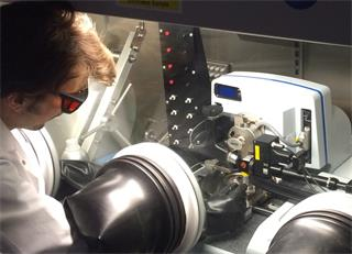 Dr Collin Becker using a combined Raman AFM system